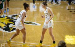Wichita State Seraphine Bastin talks to Carla Bremaud before an inbound play. The game was held at Charles Koch Area on February 3, 2021.
