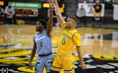 Wichita State junior Dexter Dennis shoot a 3-pointer during the game against Tulane at Charles Koch Arena on Feb. 3.