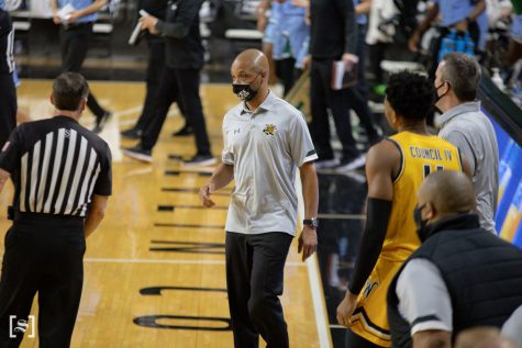 Interim Head Coach Isaac Brown talks to a ref during the game against Tulane at Charles Koch Arena on Feb. 3.