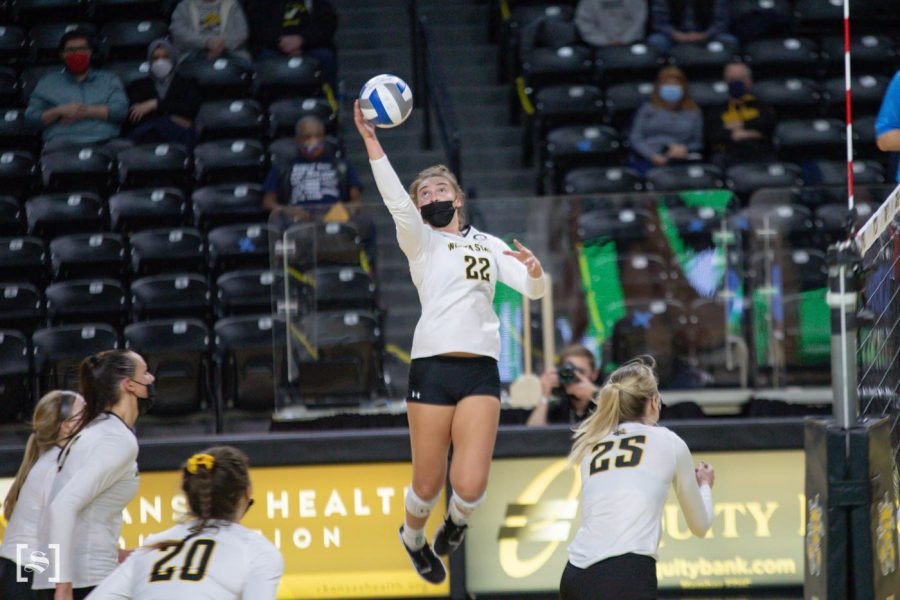 Wichita State freshman Morgan Weber spikes the ball during the game against North Texas at Charles Kock Arena on Feb. 4.