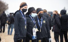 McKenna Paintin, Winny Koskei, and Yazmine Wright pose for picture after the awards ceremony. The American Athletic Conference Cross Country Championships was held at 4 Mile Creek Resort, on Feb 6.