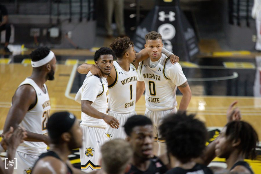 Wichita+State+players+gather+together+at+crunch+time+during+the+game+against+Temple+at+Charles+Koch+Arena+on+Feb.+7.