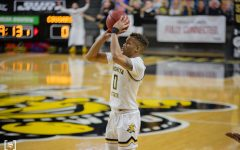 Wichita State junior Dexter Dennis takes a jump shot during the game against Houston at Charles Koch Arena on Feb. 18.