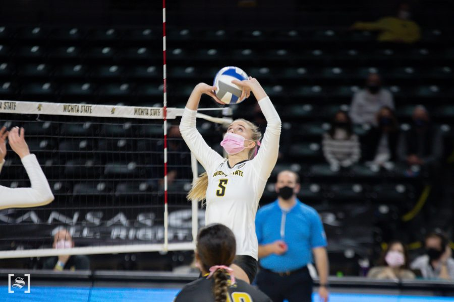 Wichita State sophomore Kayce Litzau sets the ball during the game against SMU at Charles Koch Arena on Feb. 27.