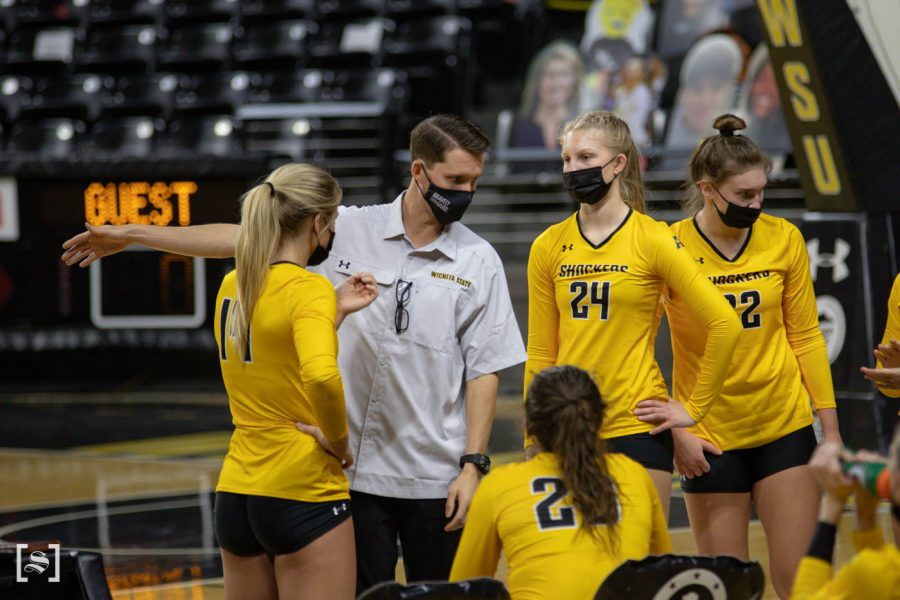 The yellow team talks at timeout during the scrimmage at Charles Kock Arena on Feb. 19.