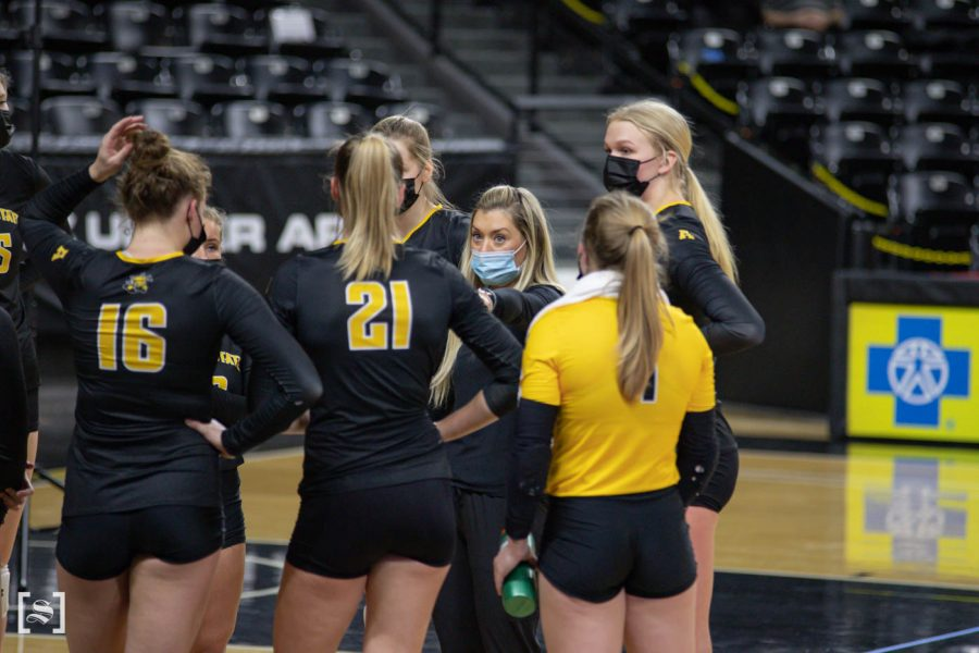 Assistant coach Chelsea Scott talks to the black team during the scrimmage at Charles Kock Arena on Feb. 19.