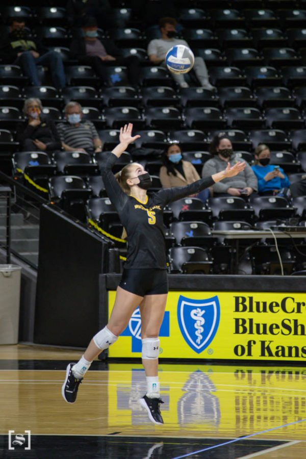 Wichita State sophomore Kayce Litzau sets the ball during the scrimmage at Charles Kock Arena on Feb. 19.