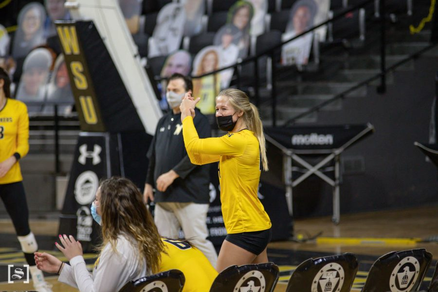 Wichita State senior McKayla Wuensch celebrates on the sidelines during the scrimmage at Charles Kock Arena on Feb. 19.