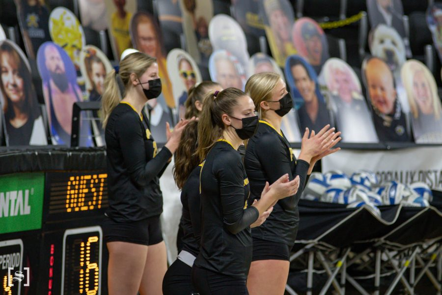 The black team cheers for their teammates on the sidelines during the scrimmage at Charles Kock Arena on Feb. 19.