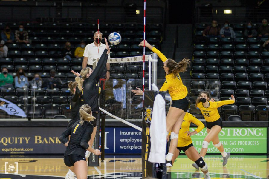 Wichita State freshman Natalie Foster spikes the ball during the scrimmage at Charles Kock Arena on Feb. 19.
