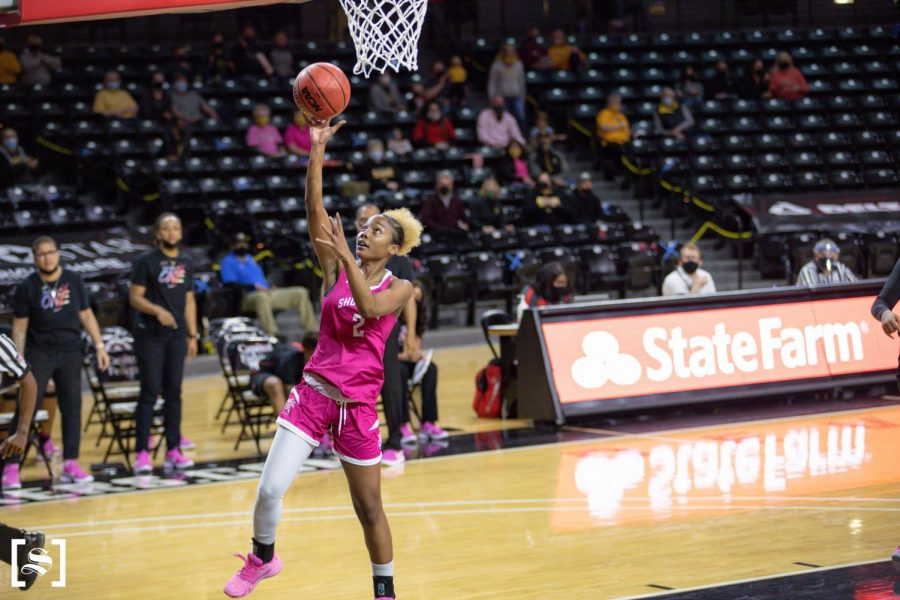 Senior Mariah McCully attempts a layup during WSU's game against Houston on Feb. 24 inside Charles Koch Arena.