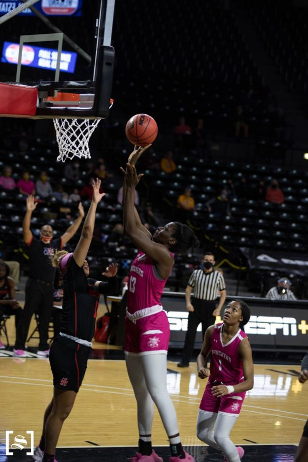 Sophomore Ene Adams attempts a layup in the Shockers' game against Houston on Feb. 24 inside Charles Koch Arena.