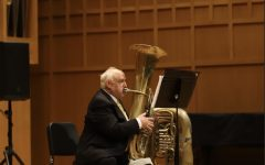 Assistant Music Professor Phillip Black plays tuba at the performance held inside Weidemann Recital Hall Sunday.