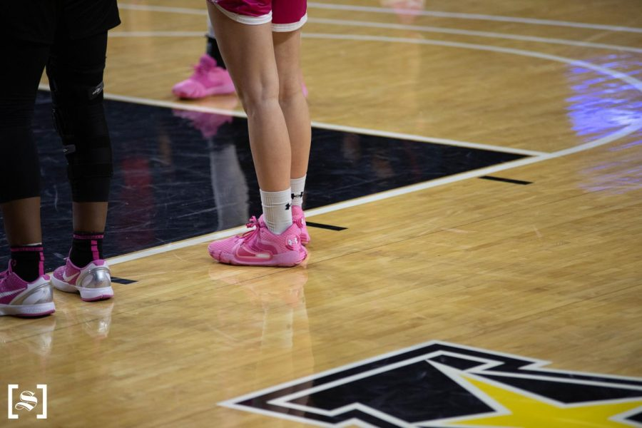 Junior Carla Bremaud sports pink shoes during WSU's Play For Kay game against Houston on Feb. 24 inside Charles Koch Arena.