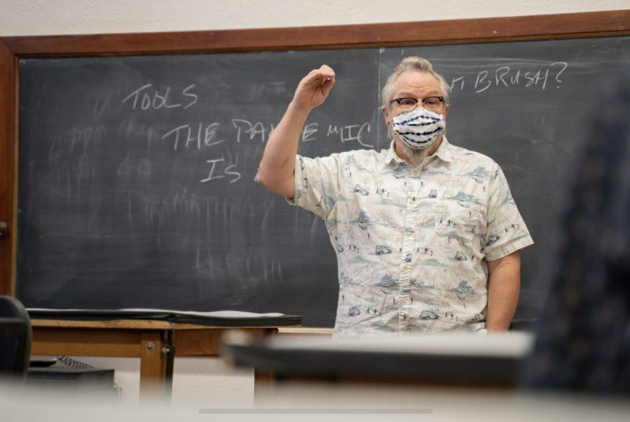 Professor Ed Baker teaches a class in Wilner Auditorium at Wichita State.