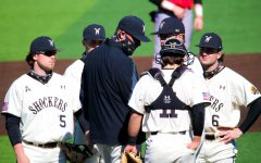 Wichita State baseball players talk to pitching coach Mike Pelfrey during a game at Eck Stadium on Feb. 28