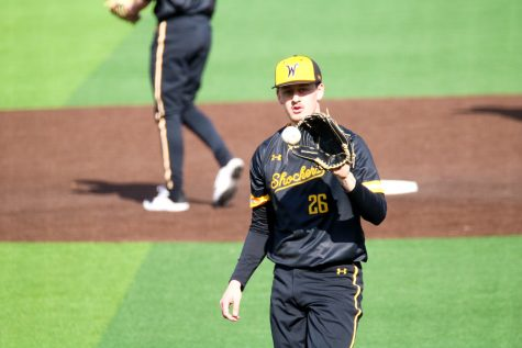 Wichita State junior, Liam Eddy catches the ball during a warmup before game at Eck stadium on Feb. 21