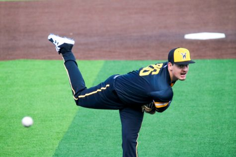 Wichita State junior, Liam Eddy throws the ball to his opponent during a game at Eck stadium on Feb. 21