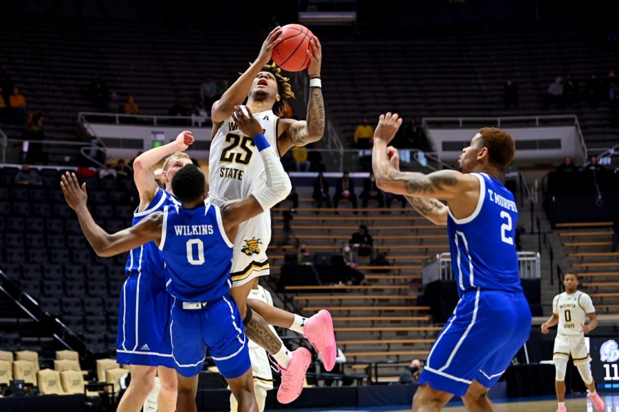 Sophomore Clarence Jackson drives to the basket in WSU's First four matchup against Drake in Mackey Arena.
