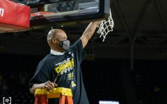 Head Coach Isaac Brown cuts the net celebrating Wichita State first AAC regular season tittle on March 6 at Charles Koch Arena.