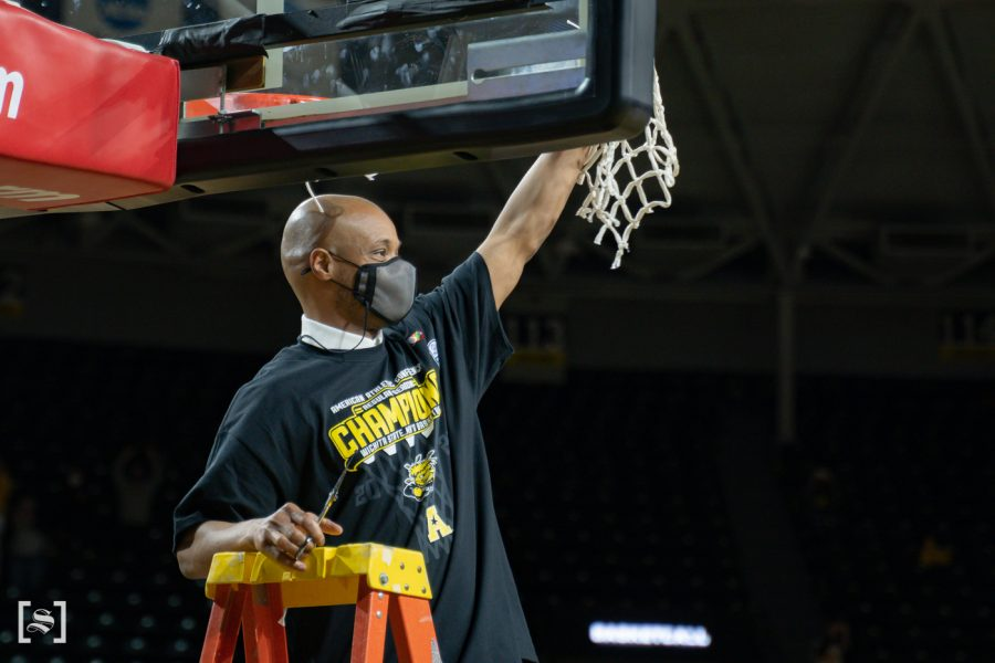 Head+Coach+Isaac+Brown+cuts+the+net+celebrating+Wichita+State+first+AAC+regular+season+tittle+on+March+6+at+Charles+Koch+Arena.
