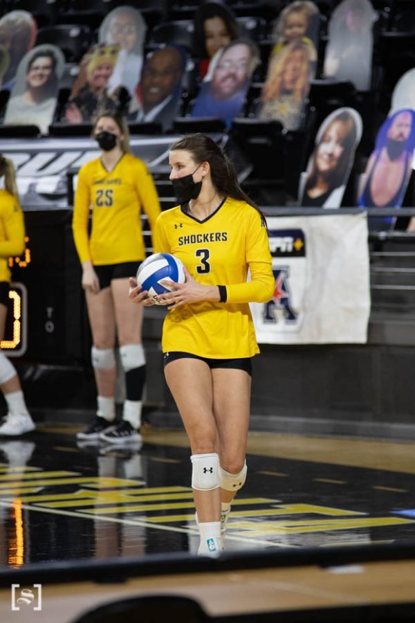 Wichita State redshirt sophomore Brylee Kelly prepares to serve the ball during the game against the Memphis Tigers at Charles Kock Arena on Mar. 5.