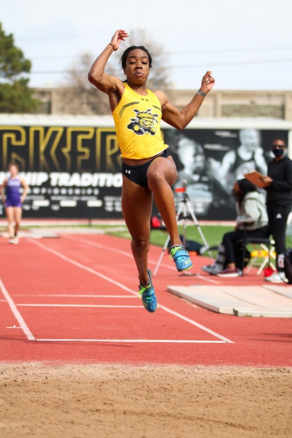 Wichita State junior, Semaj Mcghee leaps in long jump event during a track meet at Cessna Stadium on March 27.