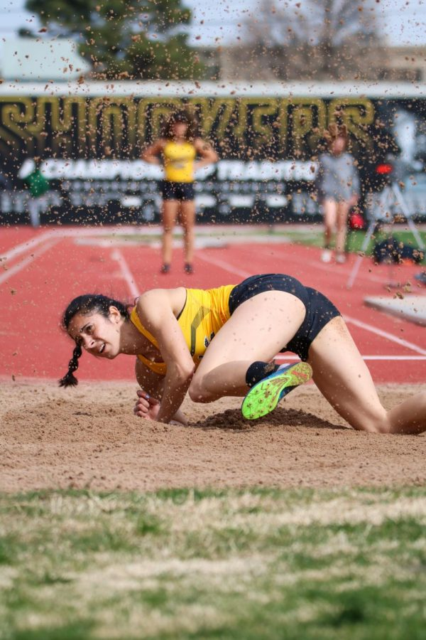 Wichita State's Maria Romero lands on the sand in long jump event during a track meet at Cessna Stadium on March 27.