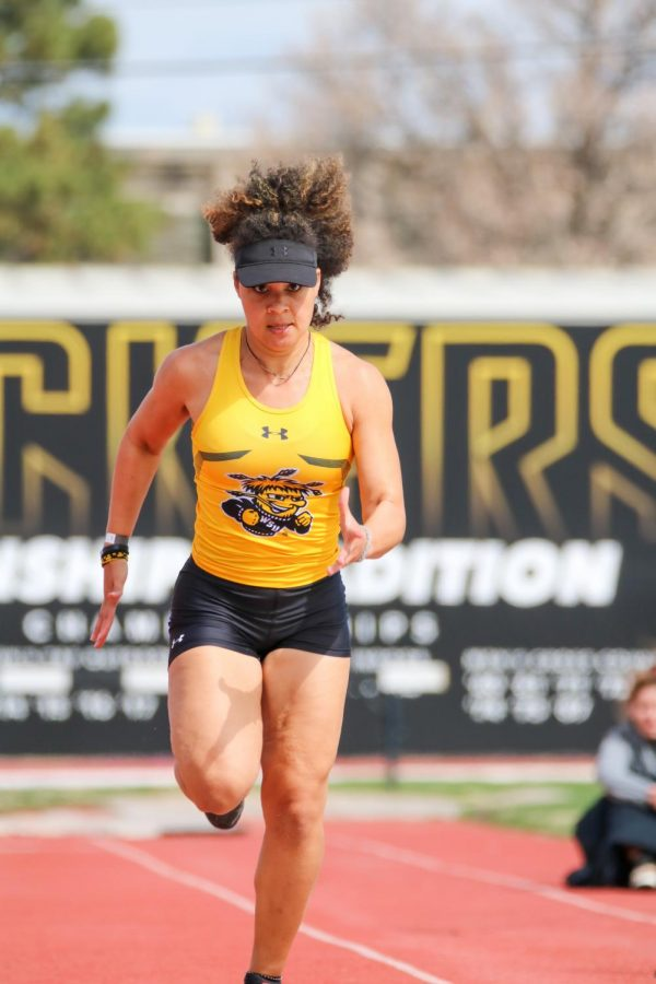 Wichita State junior, Antycia Cole prepares to jump in long jump event during a track meet at Cessna Stadium on March 27.