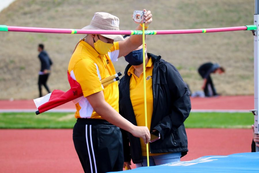 Wichita State officals measure the pole during a track meet at Cessna Stadium on March 27.