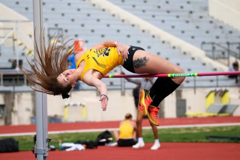 Wichita State graduate, Shania Vannoster leaps in high jump event during a track meet at Cessna Stadium on March 27.