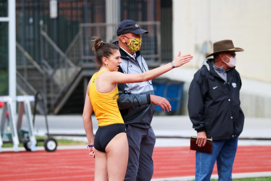 Wichita State track runner and the director of track and field, Steve Rainbolt converse after her high jump event during a track meet at Cessna Stadium on March 27.