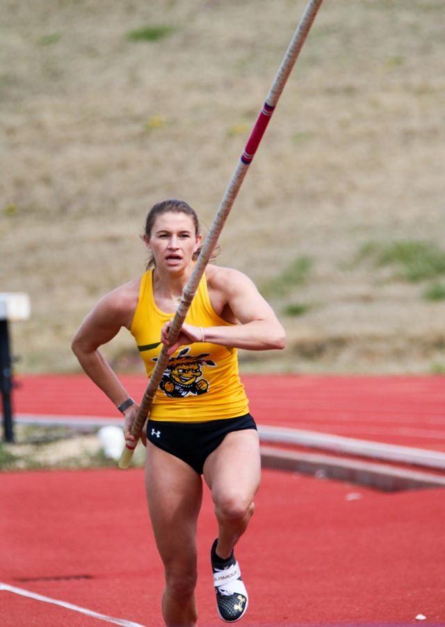 Wichita State junior, Margaux Thompson takes off during a pole vault event at a track meet at Cessna Stadium on March 27.