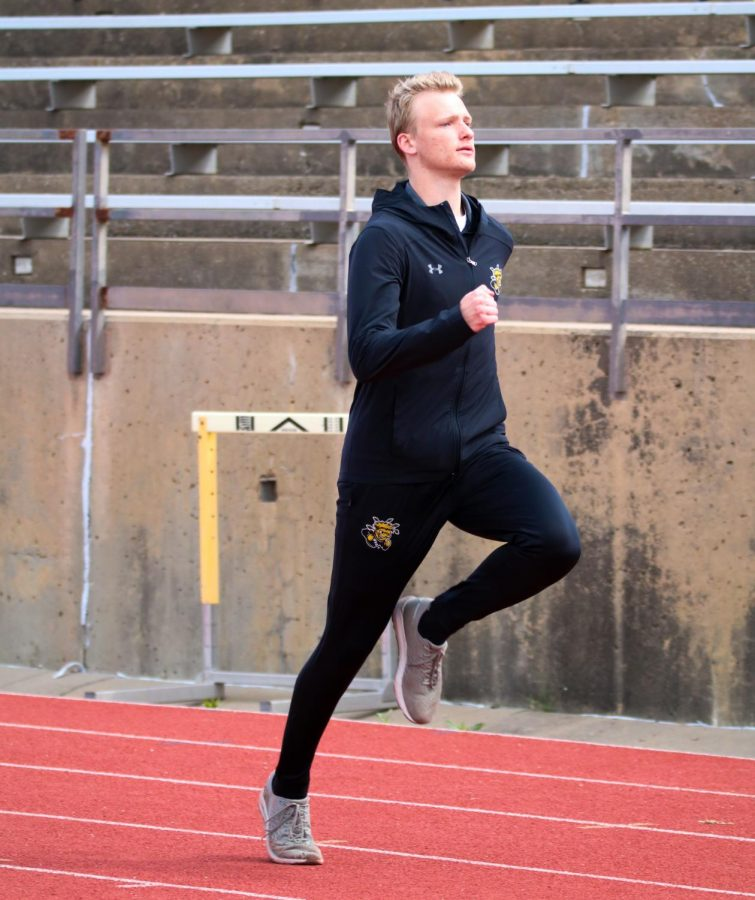 Wichita State track runner prepares for his race by sprinting at a track meet at Cessna Stadium on March 27.