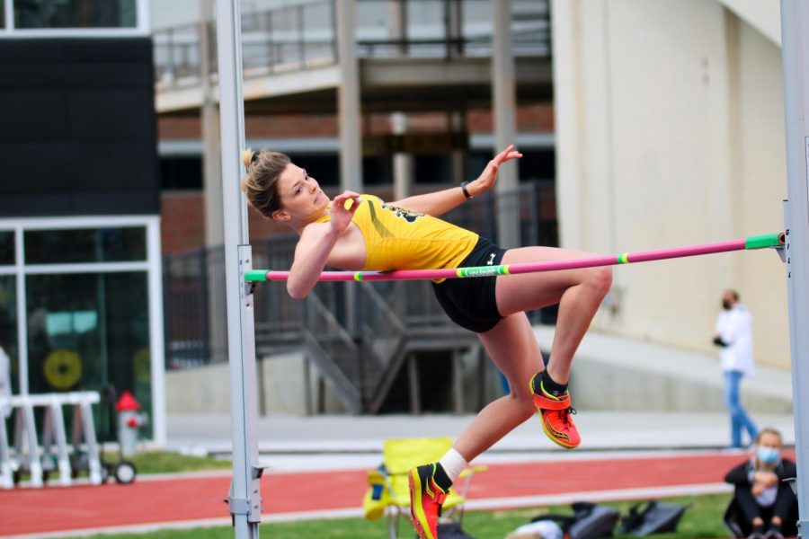 Wichita State freshman, Destiny Masters jumps over the pole during a track meet at Cessna Stadium on March 27.