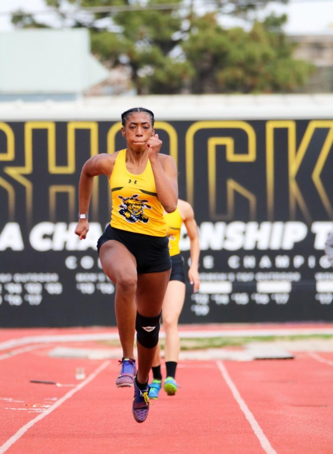 Wichita State junior, Semaj Mcghee sprints to leap in a long jump event during a track meet at Cessna Stadium on March 27.