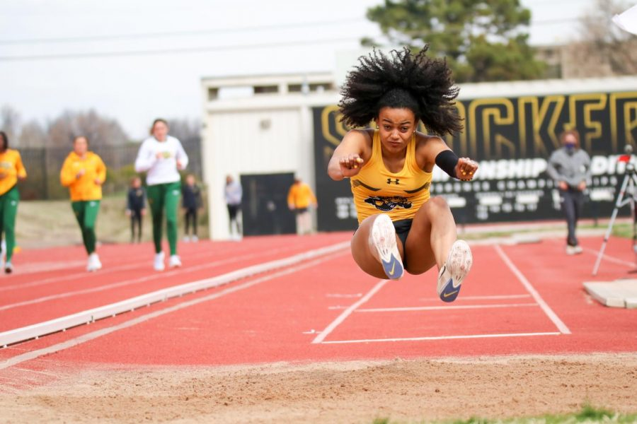 Wichita State's Nerea Quiros sprints to leap in a long jump event during a track meet at Cessna Stadium on March 27.