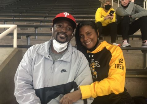 Nelson and Tiffany Wade prepare to watch their sons Trey and Trevin during WSU