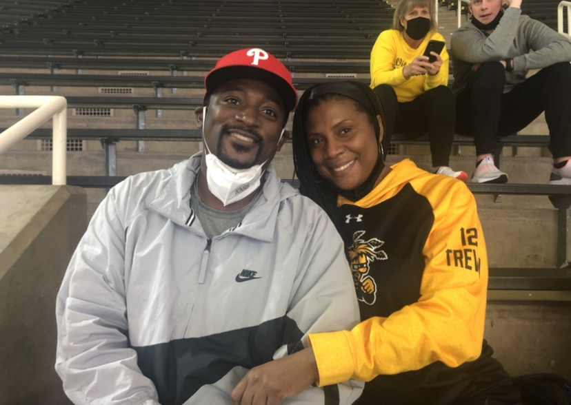 Nelson and Tiffany Wade prepare to watch their sons Trey and Trevin during WSU's First Four matchup against Drake on Thursday.