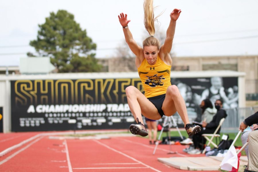 Wichita State track runner sprints to leap in a long jump event during a track meet at Cessna Stadium on March 27.