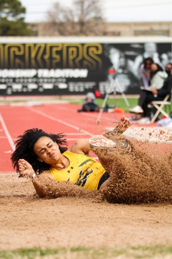 Wichita State's Nerea Quiros lands in the sand in a long jump event during a track meet at Cessna Stadium on March 27.