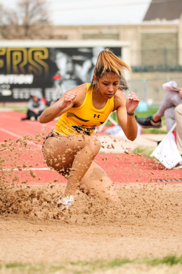 Wichita State track runner lands in the sand in a long jump event during a track meet at Cessna Stadium on March 27.