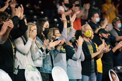 Fans cheer on the seniors during the presentation after the final game of the season at Charles Koch Arena.
