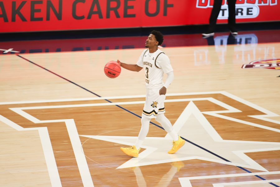 Wichita State redshirt senior Alterique Gilbert dribbles up the court during the game against USF at Dickies Arena on Mar. 12.