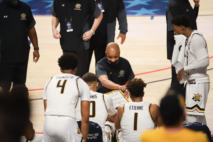Head Coach Isaac Brown talks to his players at the end of a tight game against USF at Dickies Arena on Mar. 12.