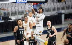 Wichita State redshirt senior Alterique Gilbert goes for a layup at the end of the game against Cincinnati at Dickies Arena on Mar. 13.