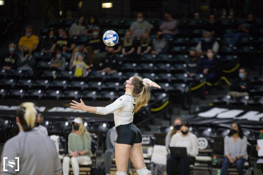 Sophomore Nicole Anderson prepares to serve during WSU's game against Houston on March 26 inside Charles Koch Arena.