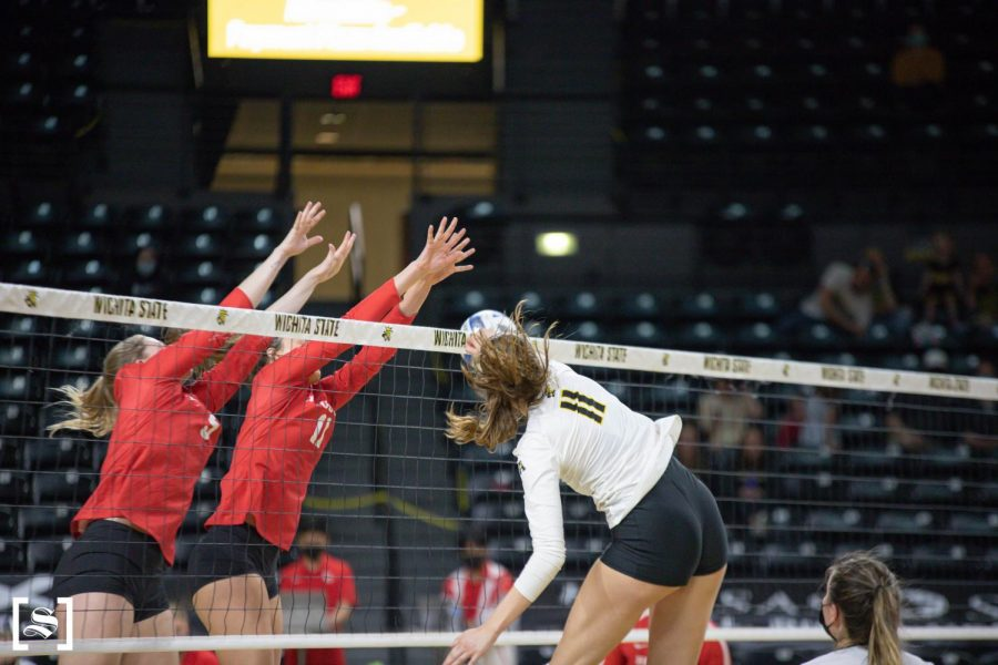 Freshman Natalie Foster attacks the ball in WSU's game against Houston on March 26 inside Charles Koch Arena.