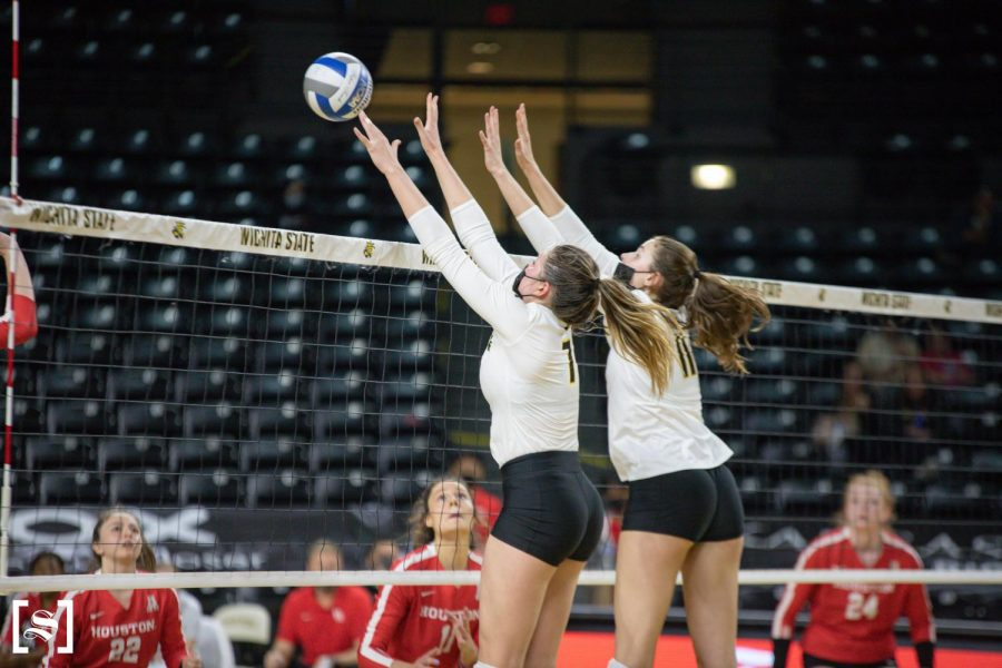 Sophomore Nicole Anderson and freshman Nicole Foster attempt to block an attack in WSU's game against Houston on March 26 inside Charles Koch Arena.
