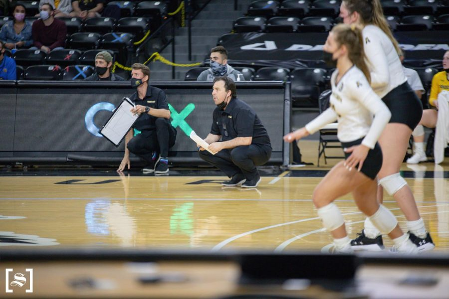 Head Coach Chris Lamb talks to a player  in WSU's game against Houston on March 26 inside Charles Koch Arena.